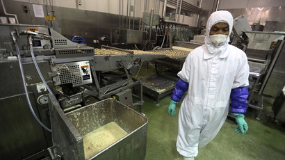 An employee works at a production line prior to a seizure conducted by officers from the Shanghai Food and Drug Administration, at the Husi Food factory in Shanghai, July 20, 2014. (Reuters)