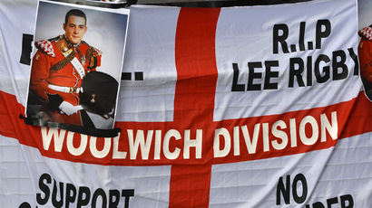 A banner and photographs of murdered soldier Lee Rigby are displayed during a protest outside the Old Bailey courthouse in London February 26, 2014. (Reuters/Toby Melville)
