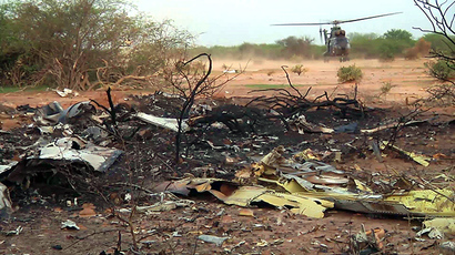 A handout photo released on July 25, 2014 by ECPAD shows the wreckage of the Air Algerie flight AH5017 which crashed in Mali's Gossi region, west of Gao. (AFP Photo)