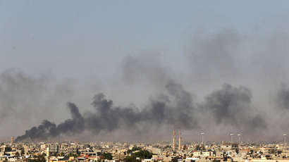 Black plumes of smoke is seen in the vicinity of Camp Thunderbolt, after clashes between militants, former rebel fighters and government forces in Benghazi July 26, 2014.(Reuters / Esam Omran Al-Fetori)