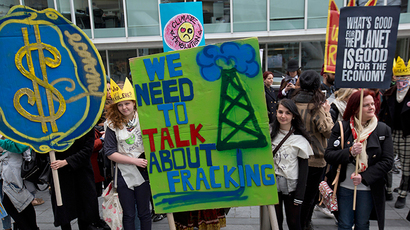 ARCHIVE PHOTO: Demonstrators hold banners during an anti-fracking protest in central London March 19, 2014 (Reuters / Neil Hall)