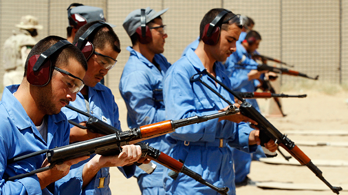 Afghan policemen load their Kalashnikovs during training in Camp Nathan Smith in Kandahar City (Reuters / Nikola Solic)