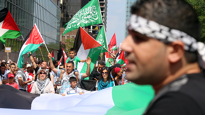People wave Palestinian flags during a demonstration against Israel's military operation in Gaza in Brussels on July 27, 2014 (AFP Photo / Nicolas Maeterlinck)