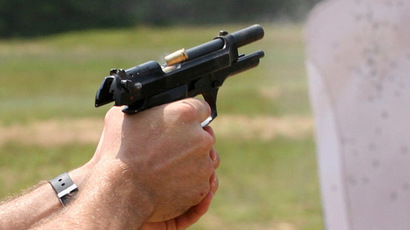Beretta M9 during firing with cartridge casing being ejected (Photo from Wikipedia.org)