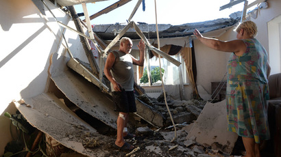 Local residents in a house damaged during a rocket and mortar attack on Horlivka, Donetsk region. (RIA Novosti/Mikhail Voskresenskiy)