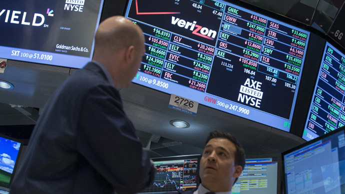 Traders work at the post where Verizon is traded on the floor of the New York Stock Exchange (Reuters/Brendan McDermid)
