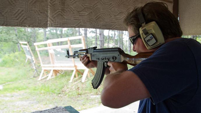 A man fires an AK-47 semi-automatic rifle at the St. Croix Rod and Gun Club in Hudson, Wisconsin. (AFP Photo / Karen Bleier)