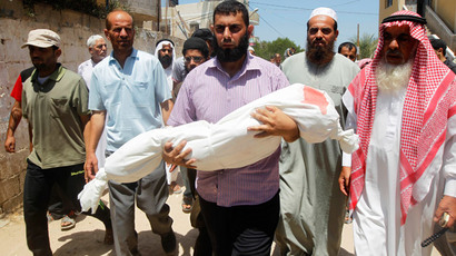 Palestinian relatives carry the body of five year old, Rana Duheir, a Palestinian girl killed in an Israeli air strike, during her funeral in Rafah in the southern Gaza Strip on July 29, 2014. (AFP Photo / Said Khatib)