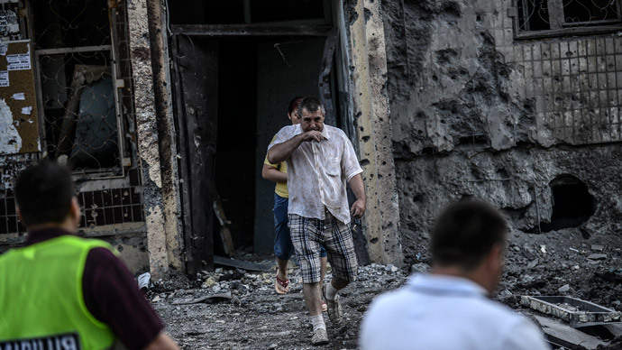 People come out from their houses after shelling in Donetsk on  (AFP Photo / Bulent Kilic)