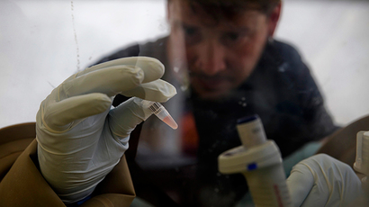 A scientist separates blood cells from plasma cells to isolate any Ebola RNA (Reuters / Misha Hussain)