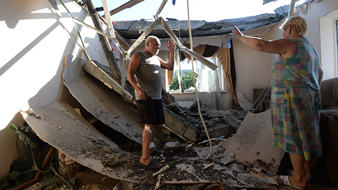 Local residents in a house damaged during a rocket and mortar attack on Horlivka, Donetsk region (RIA Novosti / Mikhail Voskresenskiy)