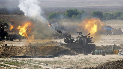 An Israeli mobile artillery unit fires towards the Gaza Strip July 28, 2014. (Reuters/Baz Ratner)