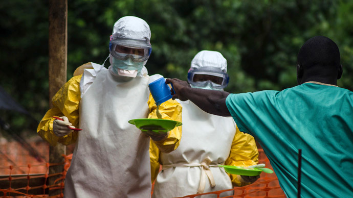 Medical staff working with Medecins sans Frontieres (MSF) prepare to bring food to patients kept in an isolation area at the MSF Ebola treatment centre in Kailahun July 20, 2014.(Reuters / Tommy Trenchard)