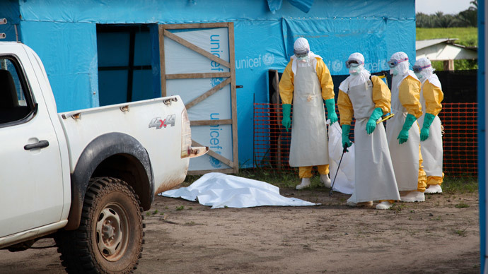 Health workers, wearing head-to-toe protective gear, prepare for work, outside an isolation unit in Foya District, Lofa County, Liberia in this July 27, 2014.(Reuters / Ahmed Jallanzo)