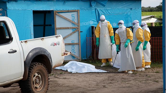 Health workers, wearing head-to-toe protective gear, prepare for work, outside an isolation unit in Foya District, Lofa County, Liberia in this July 2014  (Reuters / Ahmed Jallanzo)