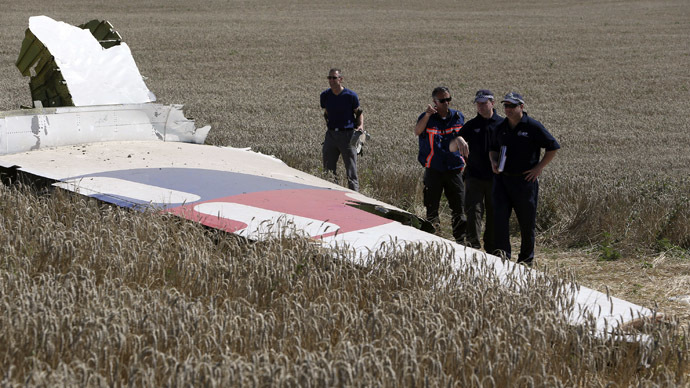 Members of a group of international experts inspect wreckage at the site where the downed Malaysia Airlines flight MH17 crashed, near the village of Hrabove (Grabovo) in Donetsk region, eastern Ukraine August 1, 2014. (Reuters/Sergei Karpukhin)