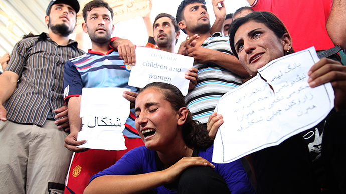 Displaced demonstrators from the minority Yazidi sect gather during a protest against militants of the Islamic State, formerly known as the Islamic State in Iraq and the Levant (ISIL), in Arbil, north of Baghdad August 4, 2014 (Reuters / Azad Lashkari)