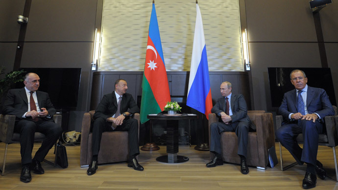 August 9, 2014. Russian President Vladimir Putin (second right) has a bilateral meeting with Azerbaijan's President Ilham Aliyev (second left) in Bocharov Ruchey residence. Right - Russian Foreign Minister Sergey Lavrov; left - Azerbaijan's Foreign Minister Elmar Mamedyarov.(RIA Novosti / Alexei Druzhinin)