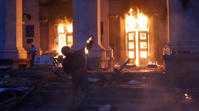 A protester throws a petrol bomb at the trade union building in Odessa May 2, 2014.(Reuters / Yevgeny Volokin)