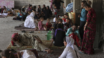 ISIS militants massacre 80 Yazidis, kidnap women in Iraqi village