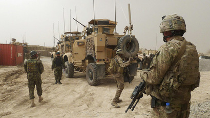 U.S. soldiers keep watch at the entrance of a U.S. base in Panjwai district Kandahar province, March 11, 2012. (Reuters)