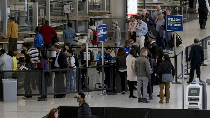 Customers wait in line at the Terminal at JFK airport in New York (Reuters)