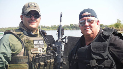 State Rep. Doug Miller (right) tours the Rio Grande Valley with Department of Public Safety officers on August 4, 2014. (Image from facebook.com)