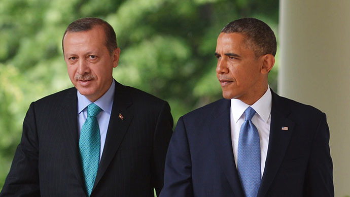 This file photo shows US President Barack Obama and Turkish Prime Minister Recep Tayyip Erdogan make their way through the Colonnade for a joint press conference in the Rose Garden of the White House on May 16, 2013 in Washington, DC. (AFP Photo / Mandel Ngan)