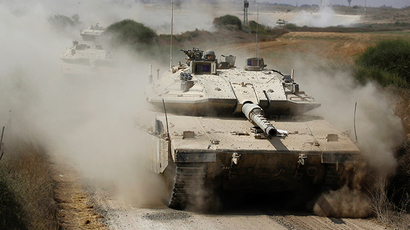 An Israeli soldier rides a tank after returning to Israel from Gaza (Reuters / Amir Cohen)