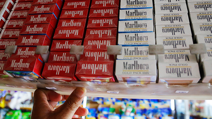 Big tobacco fuming: Philip Morris threatens to sue over plain cigarette packaging