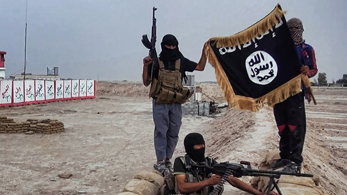 An image made available on the jihadist website Welayat Salahuddin shows militants of the Islamic State of Iraq and the Levant (ISIL) posing with the trademark Jihadists flag after they allegedly seized an Iraqi army checkpoint in the northern Iraqi province of Salahuddin. (AFP Photo)