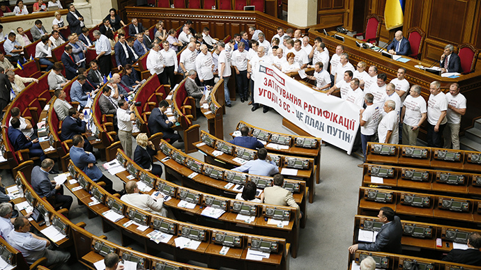 Members of the Batkivshchyna (Fatherland) political party hold a banner during a session of the parliament in Kiev August 14, 2014. (Reuters / Gleb Garanich)