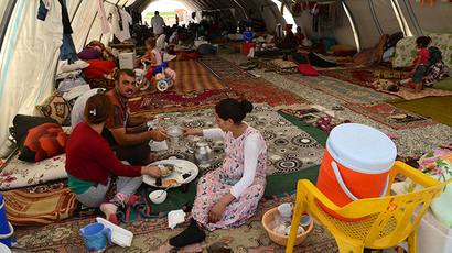 Iraqi people from the Yazidi community are pictured in a refugee camp near the Turkey-Iraq border at Silopi in Sirnak on August 14, 2014. (AFP Photo / Ilyas Akengin)