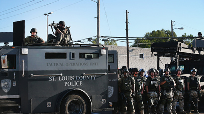 Police stand watch as demonstrators protest the shooting death of teenager Michael Brown on August 13, 2014 in Ferguson, Missouri. (AFP Photo / Getty Images / Scott Olson)