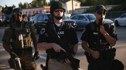 Police take up position to control demonstrators who were protesting the killing of teenager Michael Brown on August 12, 2014 in Ferguson, Missouri. (AFP Photo / Getty Images / Scott Olson)
