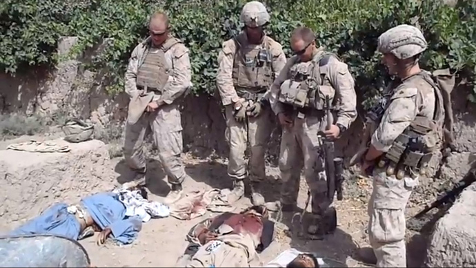 A still image taken January 11, 2012 from an undated YouTube video shows what is believed to be U.S. Marines urinating on the bodies of dead Taliban soldiers in Afghanistan.(Reuters / YouTube)