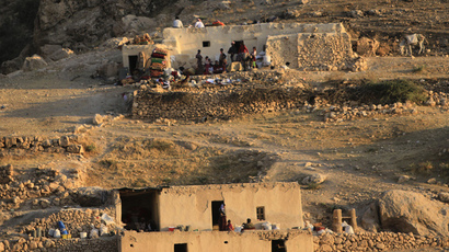 Displaced people from the minority Yazidi sect, who fled the violence from forces loyal to the Islamic State in Sinjar town, settle in abandoned houses as they take shelter in Mount Sinjar (Reuters / Rodi Said)