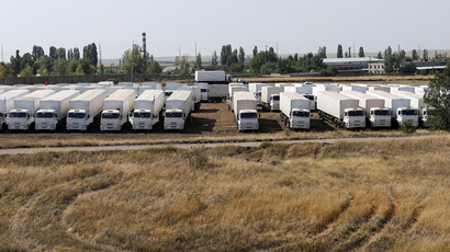 A Russian convoy of trucks carrying humanitarian aid for Ukraine is parked at a camp near Kamensk-Shakhtinsky, Rostov Region, August 16, 2014. (Reuters/Maxim Shemetov)