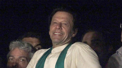 Imran Khan (C), cricketer-turned-opposition politician and chairman of the Pakistan Tehreek-e-Insaf (PTI) political party, smiles to his supporters after his speech during the fourth day of the Freedom March in Islamabad August 17, 2014. (Reuters/Faisal Mahmood)