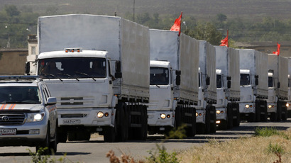 A Russian convoy of trucks carrying humanitarian aid for Ukraine drives along a road from Kamensk-Shakhtinsky in the direction of the border with Ukraine, Rostov Region, August 17, 2014. (Reuters/Alexander Demianchuk)