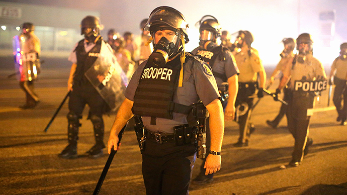 Police advance through a cloud of tear gas toward demonstrators protesting the killing of teenager Michael Brown on August 17, 2014 in Ferguson, Missouri. (AFP Photo / Getty Images / Scott Olson)