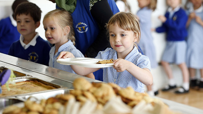 Students receive their lunch at Salusbury Primary School in northwest London (Reuters / Suzanne Plunkett)