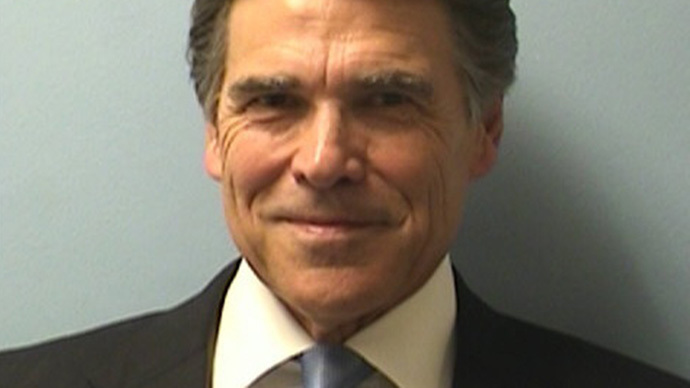 Texas Gov. Rick Perry turns himself in for grand jury indictment