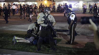 Police detain a demonstrator during a protest against the shooting death of Michael Brown in Ferguson Missouri August 18, 2014. (Reuters / Joshua Lott)