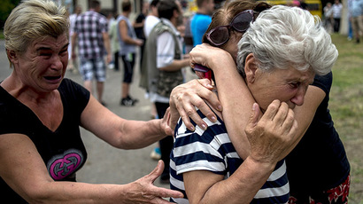 People in Lugansk after an artillery attack on the city. (RIA Novosti / Valeriy Melnikov)