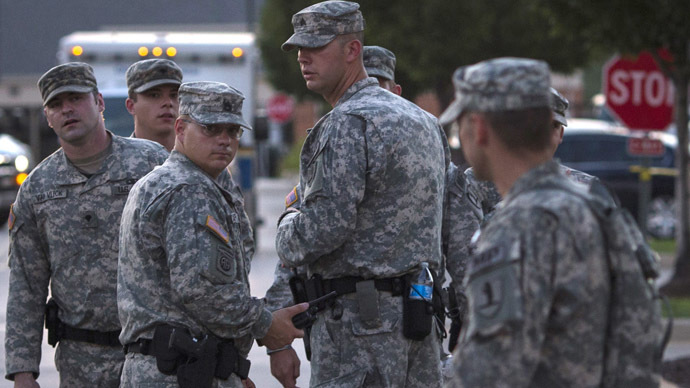 National Guard troops stand at a staging area located at a shopping center parking lot in Ferguson, Missouri August 21, 2014. (Reuters/Adrees Latif)