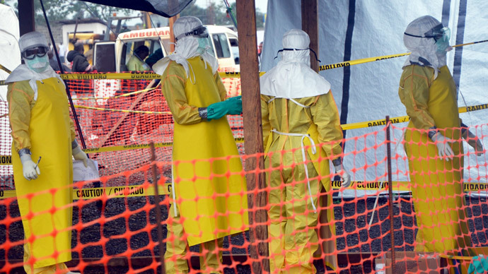 French NGO Medecins Sans Frontieres (MSF - Doctors Without Borders) staff members standing wearing protective gear at the MSF ELWA hospital in Monrovia, where patients suffering from Ebola are taken care of.(AFP Photo / Zoom Dosso )