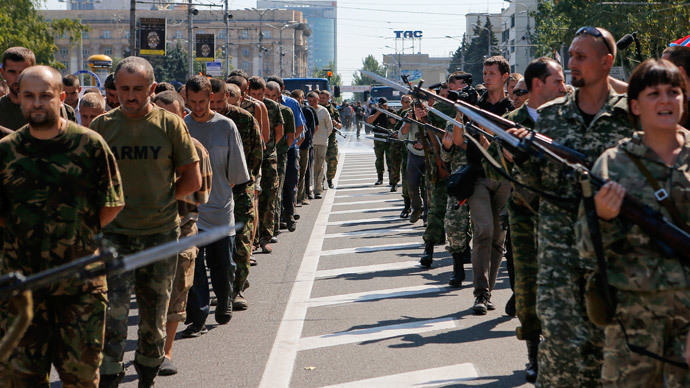 Anti-government fighters escort a column of Ukrainian prisoners of war as they walk across the centre of Donetsk August 24, 2014.(Reuters / Maxim Shemetov)