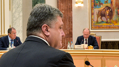 Ukraine's President Petro Poroshenko (front), Russia's President Vladimir Putin (R) and Foreign Minister Sergei Lavrov attend a meeting with high-ranked officials representing Russia, Belarus, Kazakhstan, Ukraine and the European Union in Minsk, August 26, 2014 (Reuters / Ukrainian Presidential Press Service)