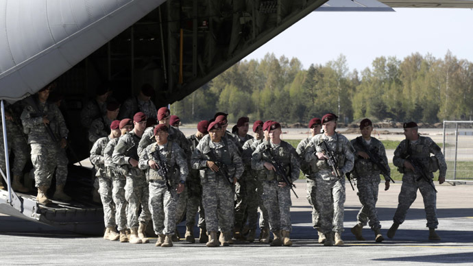 First company-sized contingent of about 150 U.S. paratroopers from the U.S. Army's 173rd Infantry Brigade Combat Team based in Italy arrive in the airport in Riga April 24, 2014. (Reuters/Ints Kalnins)